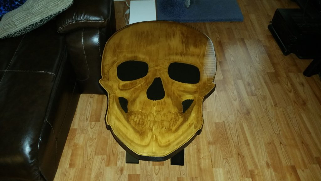 3D skull table, skull coffee table, carved skull coffee table, carved coffee table, handcrafted coffee table, custom coffee table, custom handcrafted coffee table, skull sculpture table